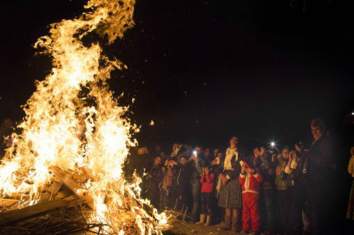 "<div class=""meta image-caption""><div class=""origin-logo origin-image none""><span>none</span></div><span class=""caption-text"">Iraqi Christians gather by a bonfire to celebrate mass in a Christian refugee camp in Irbil, northern Iraq.  (AP Photo/ Seivan M. Salim)</span></div>"