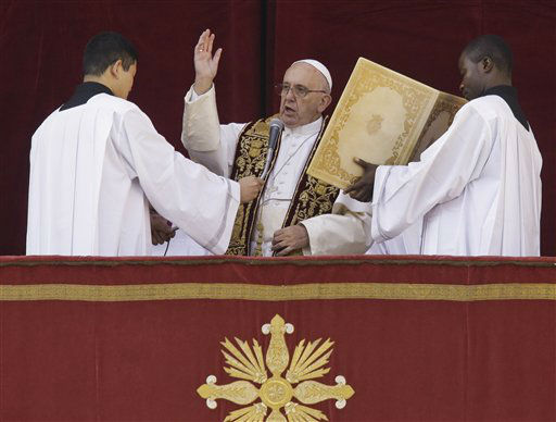 """<div class=""""meta image-caption""""><div class=""""origin-logo origin-image none""""><span>none</span></div><span class=""""caption-text"""">Pope Francis delivers his """"Urbi et Orbi"""" (to the city and to the world) blessing from the central balcony of St. Peter's Basilica at the Vatican.  (AP Photo/ Gregorio Borgia)</span></div>"""