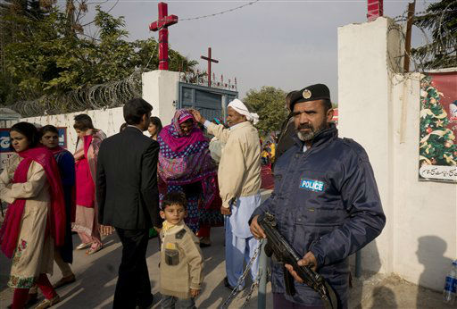 """<div class=""""meta image-caption""""><div class=""""origin-logo origin-image none""""><span>none</span></div><span class=""""caption-text"""">People from Pakistani Christian community leave a local church after attending Christmas mass at a local church in Islamabad, Pakistan.  (AP Photo/ B.K. Bangash)</span></div>"""
