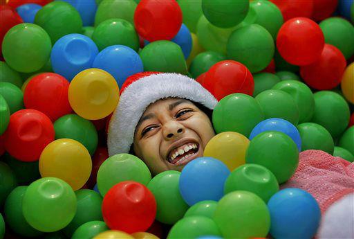 "<div class=""meta image-caption""><div class=""origin-logo origin-image none""><span>none</span></div><span class=""caption-text"">A Bangladeshi Christian girl is all smiles as she plays at a Christmas party in Dhaka, Bangladesh.  (AP Photo/ A.M. Ahad)</span></div>"
