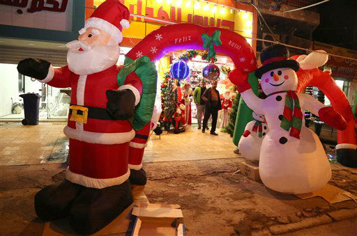"<div class=""meta image-caption""><div class=""origin-logo origin-image none""><span>none</span></div><span class=""caption-text"">Iraqi Christians buy a Christmas decorations item in central Baghdad, Iraq, Thursday.  (AP Photo/ Karim Kadim)</span></div>"