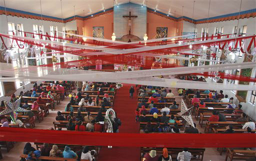 "<div class=""meta image-caption""><div class=""origin-logo origin-image none""><span>none</span></div><span class=""caption-text"">Indian Christians offer prayers at a decorated Saint Mary's Garrison Church on the occasion of Christmas in Jammu, India.  (AP Photo/ Channi Anand)</span></div>"