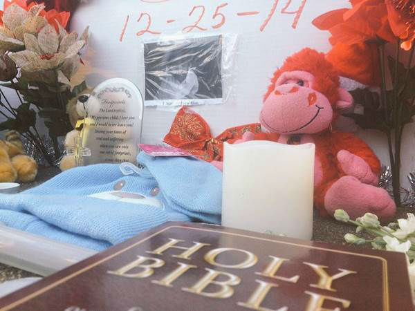 <div class='meta'><div class='origin-logo' data-origin='none'></div><span class='caption-text' data-credit='WTVD Photo/ WTVD/Elaina Athans'>Memorial growing for 2-year-old Tristan Blue.</span></div>