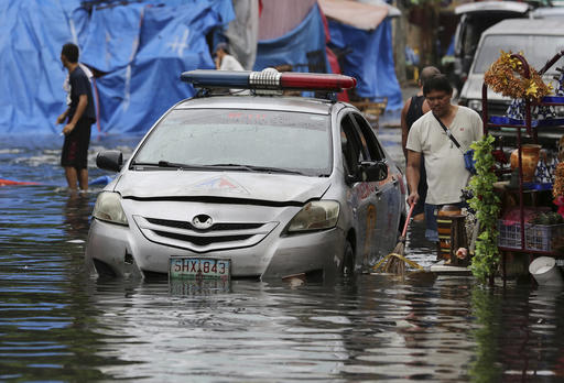 "<div class=""meta image-caption""><div class=""origin-logo origin-image none""><span>none</span></div><span class=""caption-text"">A police car is parked along a flooded street caused by rains from Typhoon Nock-Ten. (AP Photo/Aaron Favila)</span></div>"