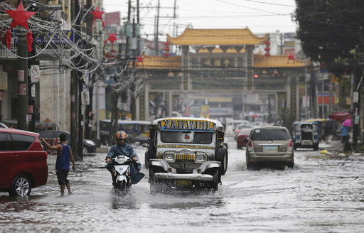 "<div class=""meta image-caption""><div class=""origin-logo origin-image none""><span>none</span></div><span class=""caption-text"">A passenger jeep navigates a flooded street caused by rains from Typhoon Nock-Ten in Quezon city, north of Manila. (AP Photo/Aaron Favila)</span></div>"