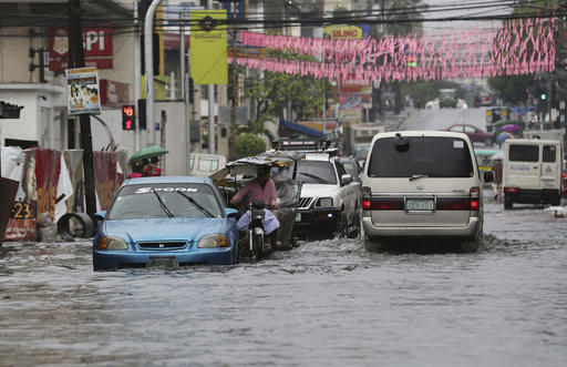 "<div class=""meta image-caption""><div class=""origin-logo origin-image none""><span>none</span></div><span class=""caption-text"">Vehicles navigate a flood-prone area caused by rains from Typhoon Nock-Ten in Quezon city, north of Manila. (AP Photo/Aaron Favila)</span></div>"