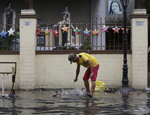 "<div class=""meta image-caption""><div class=""origin-logo origin-image none""><span>none</span></div><span class=""caption-text"">A man cleans the trash along a flooded area outside a church caused by rains from Typhoon Nock-Ten in Quezon city, north of Manila. (AP Photo/Aaron Favila)</span></div>"