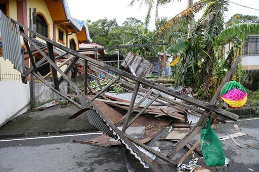 "<div class=""meta image-caption""><div class=""origin-logo origin-image none""><span>none</span></div><span class=""caption-text"">A damaged portion of a house partially blocks the road after being destroyed by typhoon Nock-Ten, at Mabini township, Batangas province south of Manila.(AP Photo/Bullit Marquez)</span></div>"