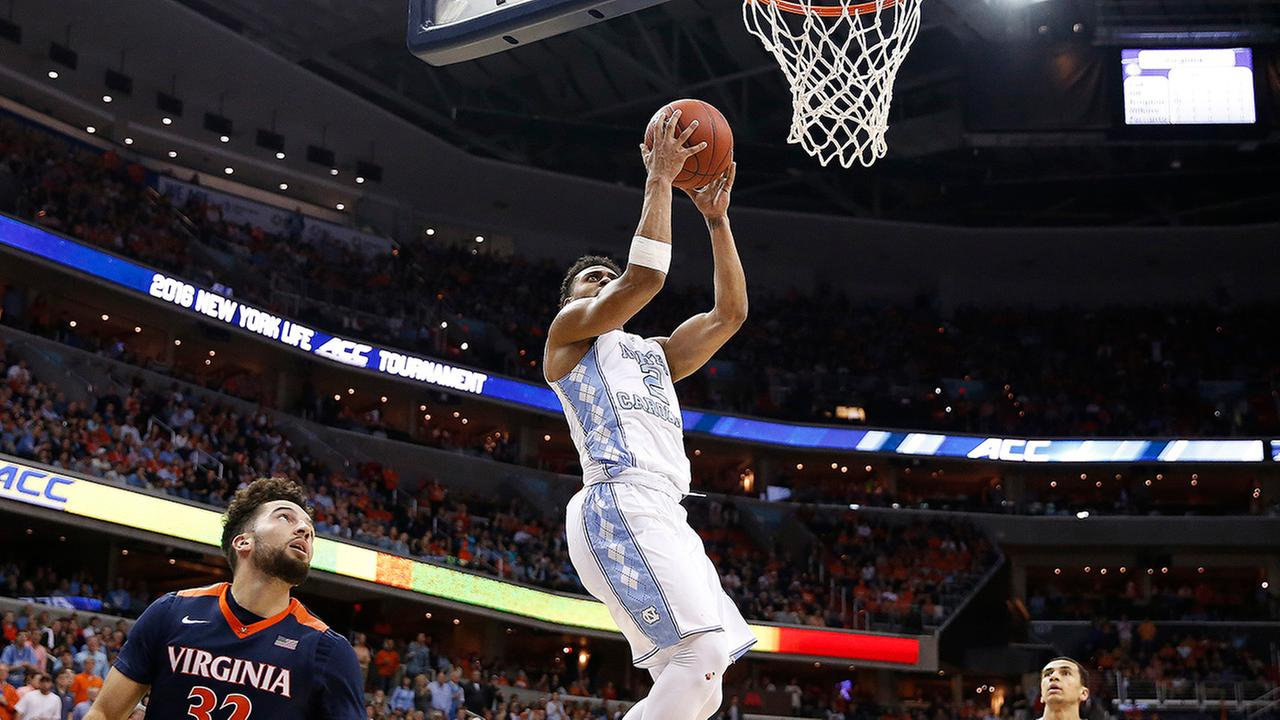 North Carolina guard Joel Berry II (2) heads to the hoop as Virginia guard London Perrantes (32) looks on during the second half of an NCAA college basketball game