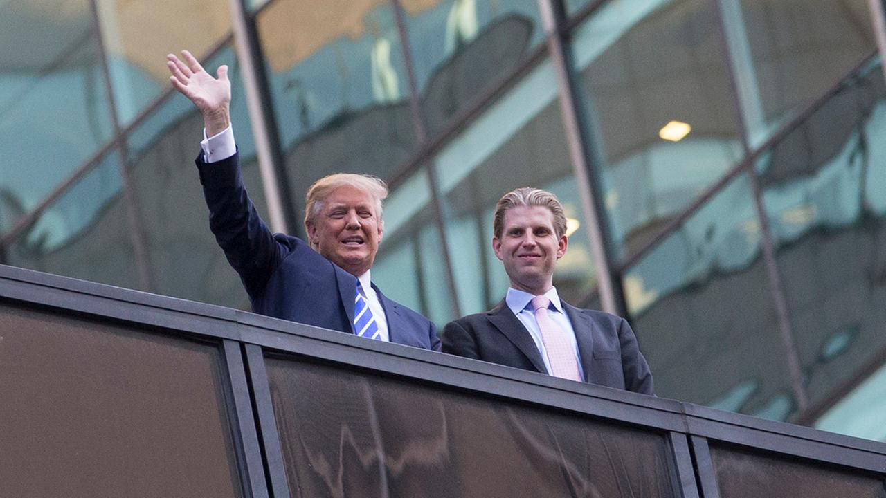 Republican presidential candidate, businessman Donald Trump, left, waves alongside his son Eric Trump Fifth Avenue