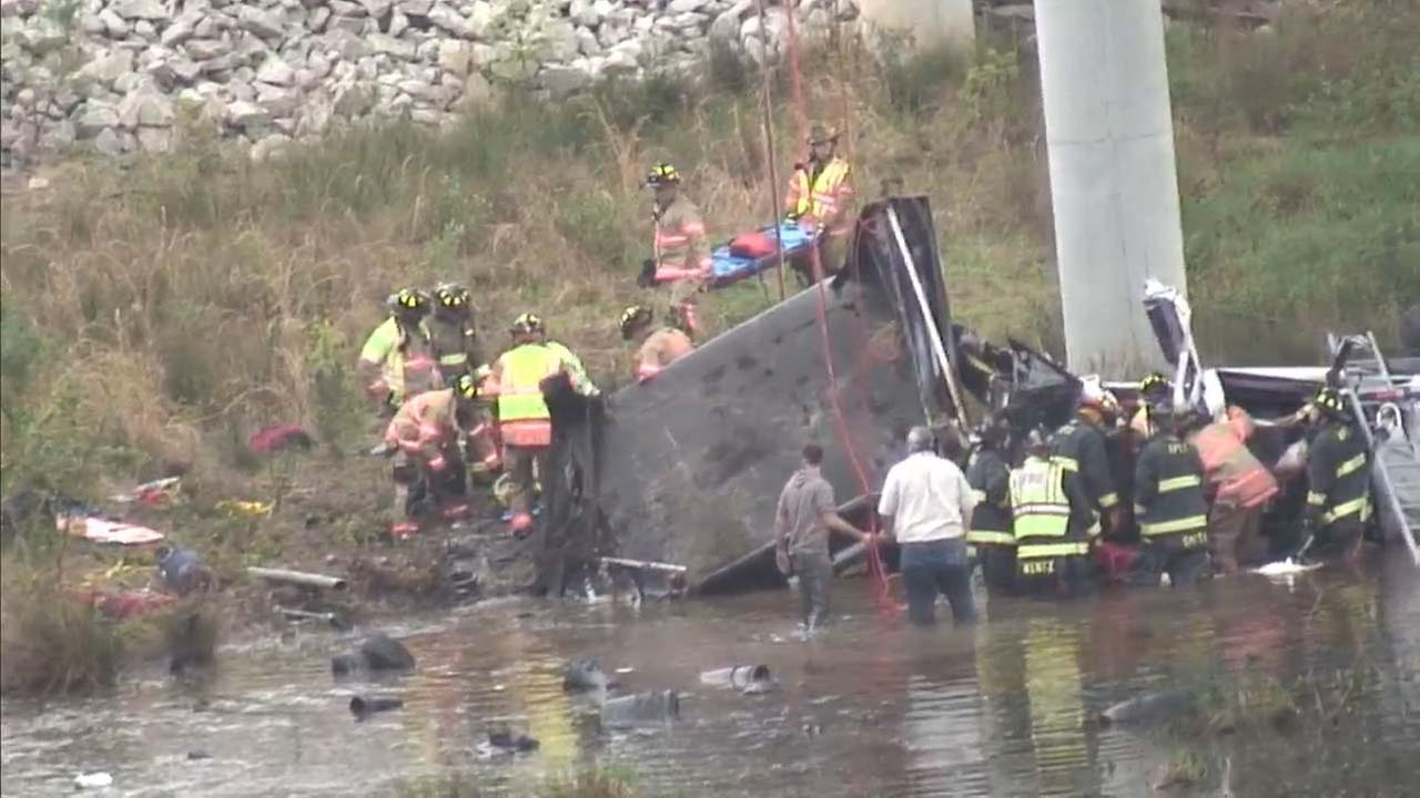 The truck landed in White Oak CreekWTVD Photo/Jim Schumacher