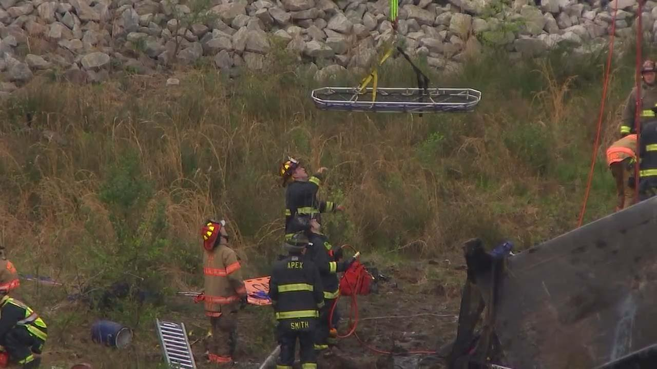 Rescuers help the victims after a horrific crash on NC540.WTVD photo/Jim Schumacher