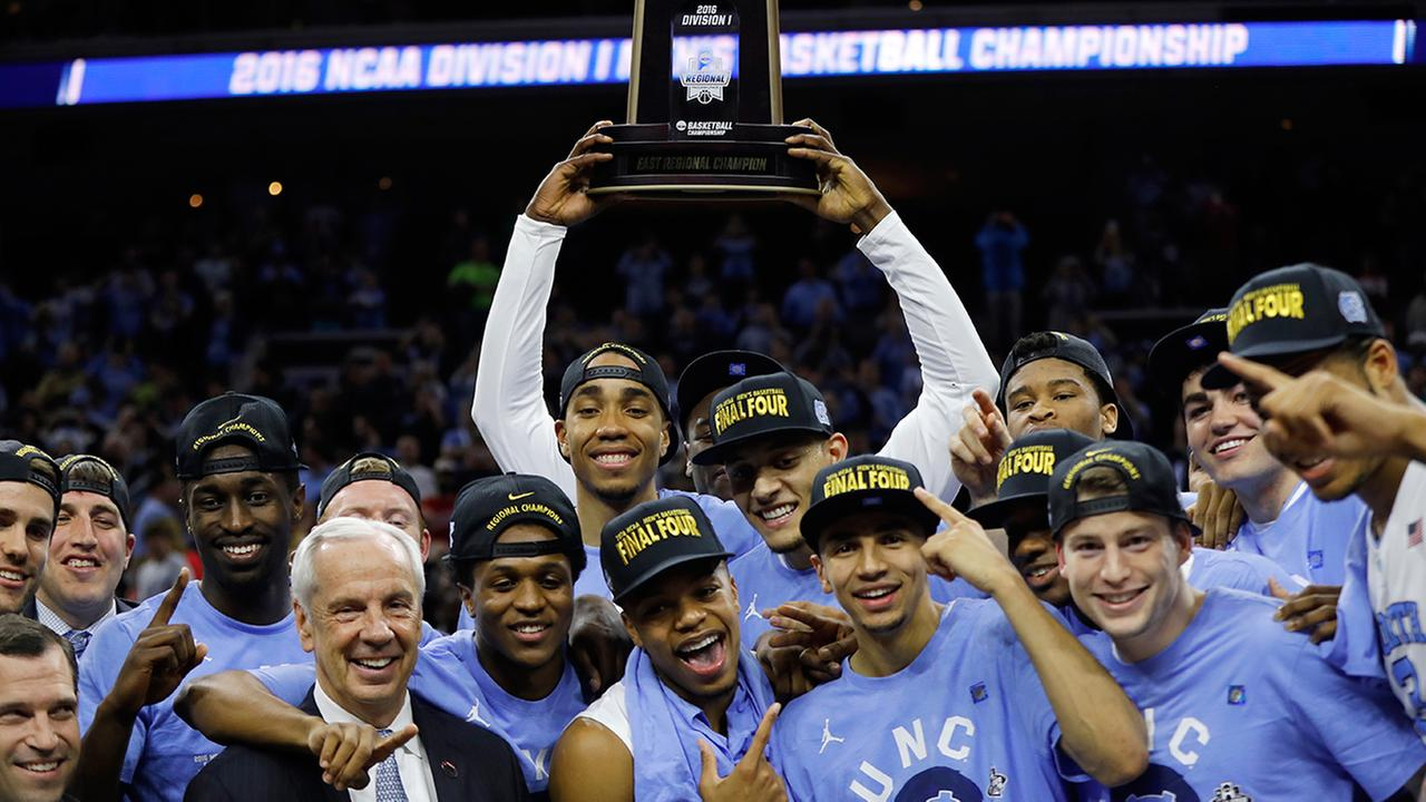 UNC celebrates after winning a regional final mens college basketball game against Notre Dame in the NCAA Tournament, Sunday, March 27, 2016, in Philadelphia.