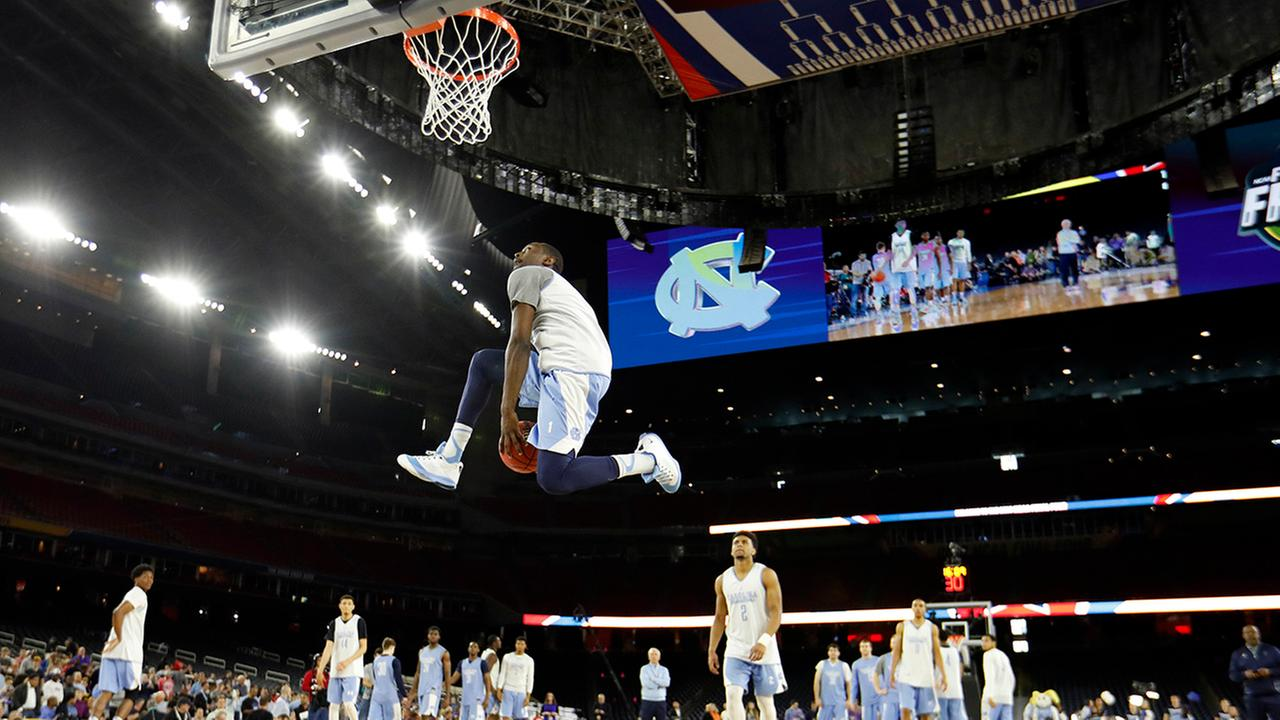 North Carolinas Theo Pinson dunks during a practice session for the NCAA Final Four college basketball tournament Friday, April 1, 2016, in Houston.