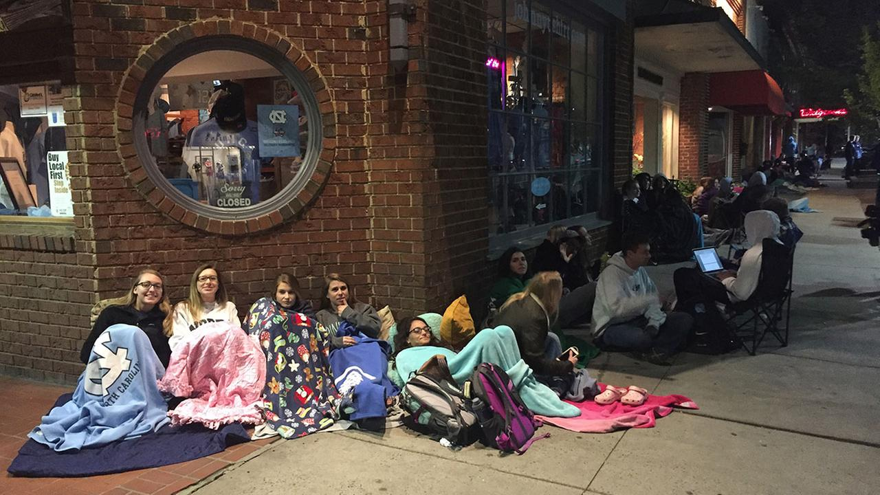 Over 150 UNC fans wait outside Top of the Hill in downtown Chapel Hill overnight just for a chance to watch the game at the restaurant.
