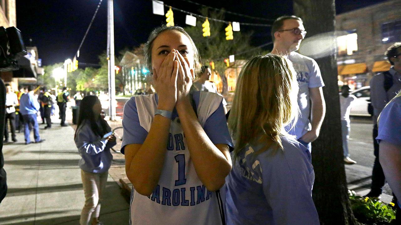 North Carolina fans react in disbelief in Chapel Hill, Monday following North Carolinas loss to Villanova.Gerry Broome