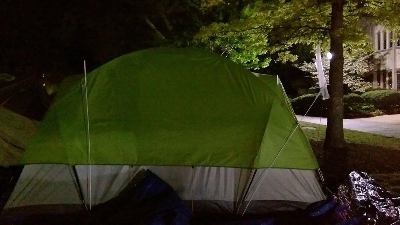 Protesters say two banners and a pride flag were stolen from outside their tent