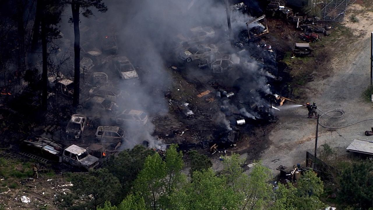 Firefighters battle a large fire at a salvage yard on Jeffries Road in northern Durham County.Chopper 11 HD