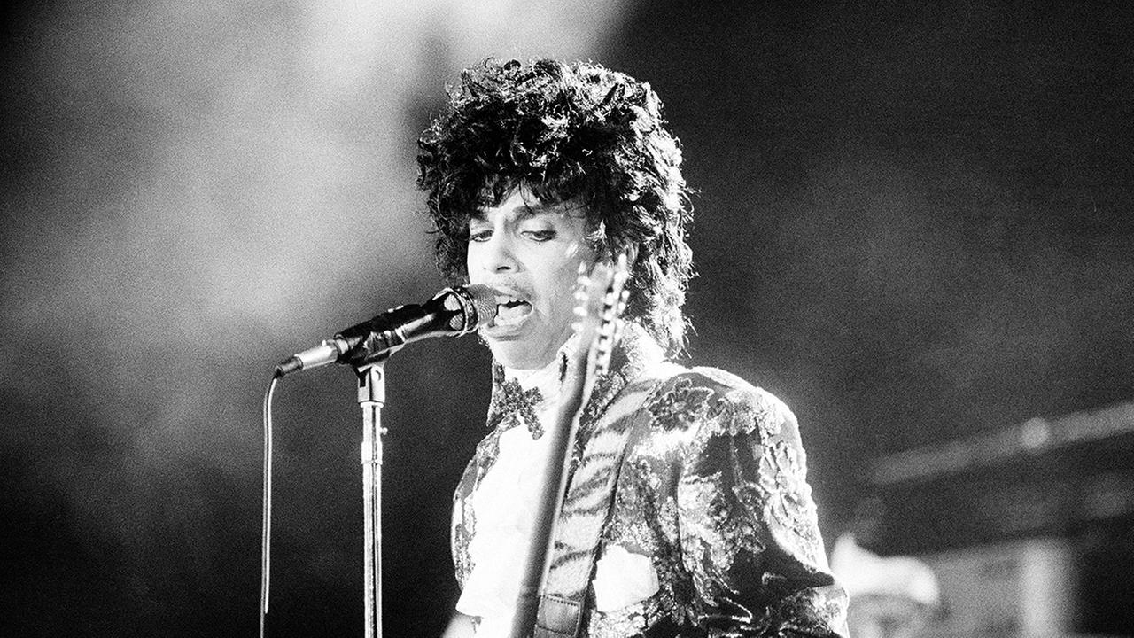 Rock singer Prince performs at the Orange Bowl during his Purple Rain tour in Miami, Fla., April 7, 1985.