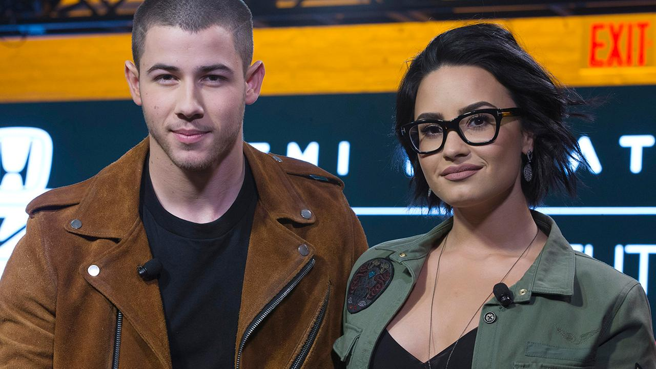 Demi Lovato, right, and Nick Jonas appear onstage during a Honda-sponsored news conference, Tuesday, March 22, 2016, in New York.