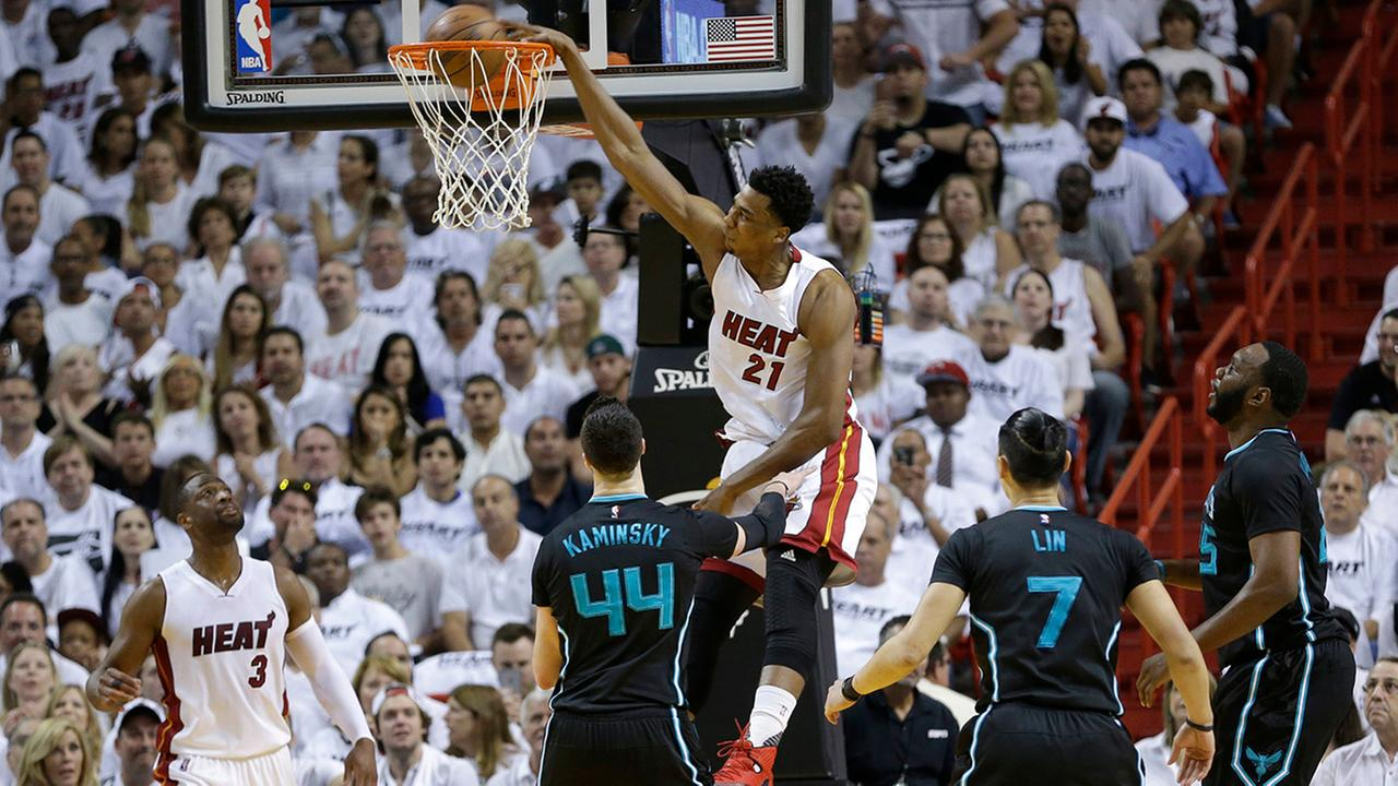 Miami Heat center Hassan Whiteside (21) dunks against the Charlotte Hornets in the first half of Game 7 of a first-round NBA basketball playoff series, Sunday, May 1, 2016