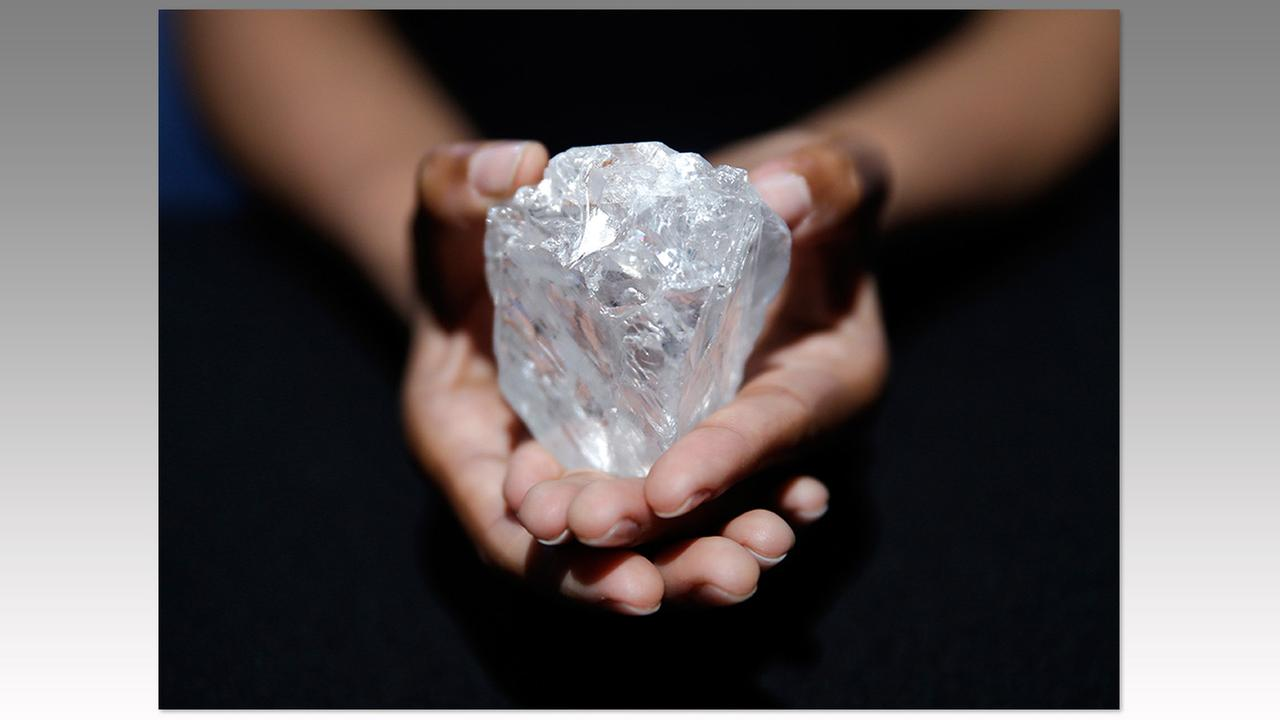 A model displays a huge diamond at Sothebys in New York on May 4. The auction house plans to offer the Lesedi la Rona diamond in London on June 29.Seth Wenig