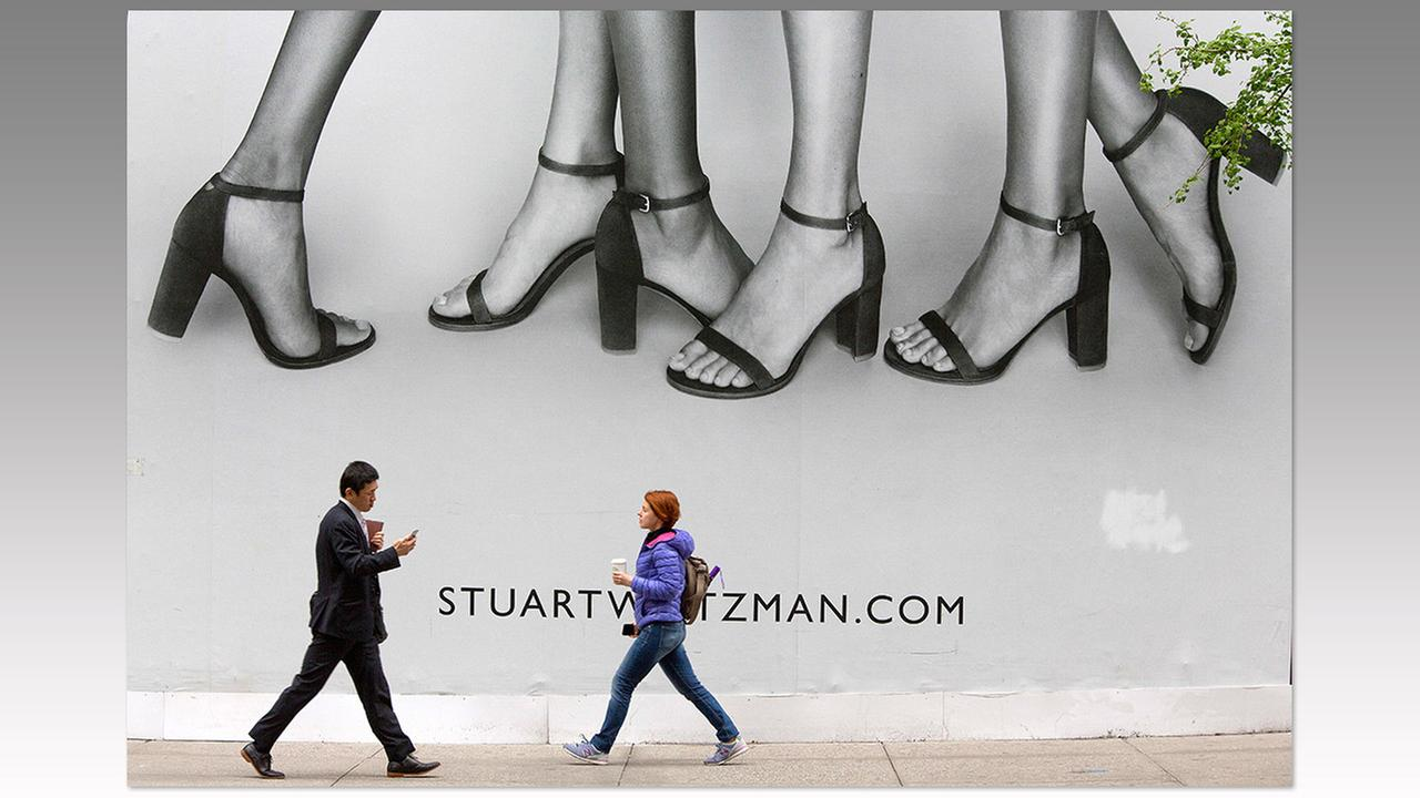 Pedestrians walk past a giant billboard on display on 5th Avenue in Midtown Manhattan on May 4 in New York.Mary Altaffer