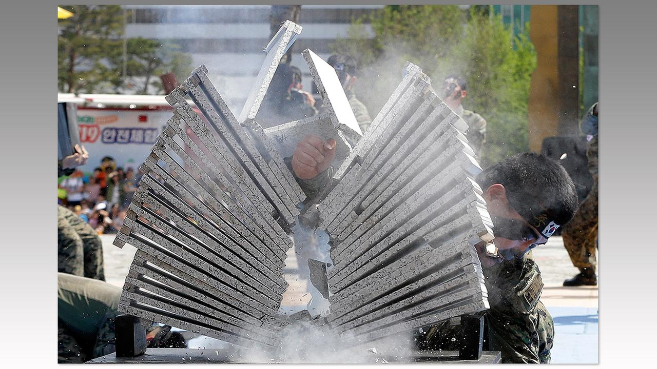 A soldier from the South Korean army special forces breaks stone plates with his hand during a martial arts demonstration on May 5 in Seoul.Ahn Young-joon