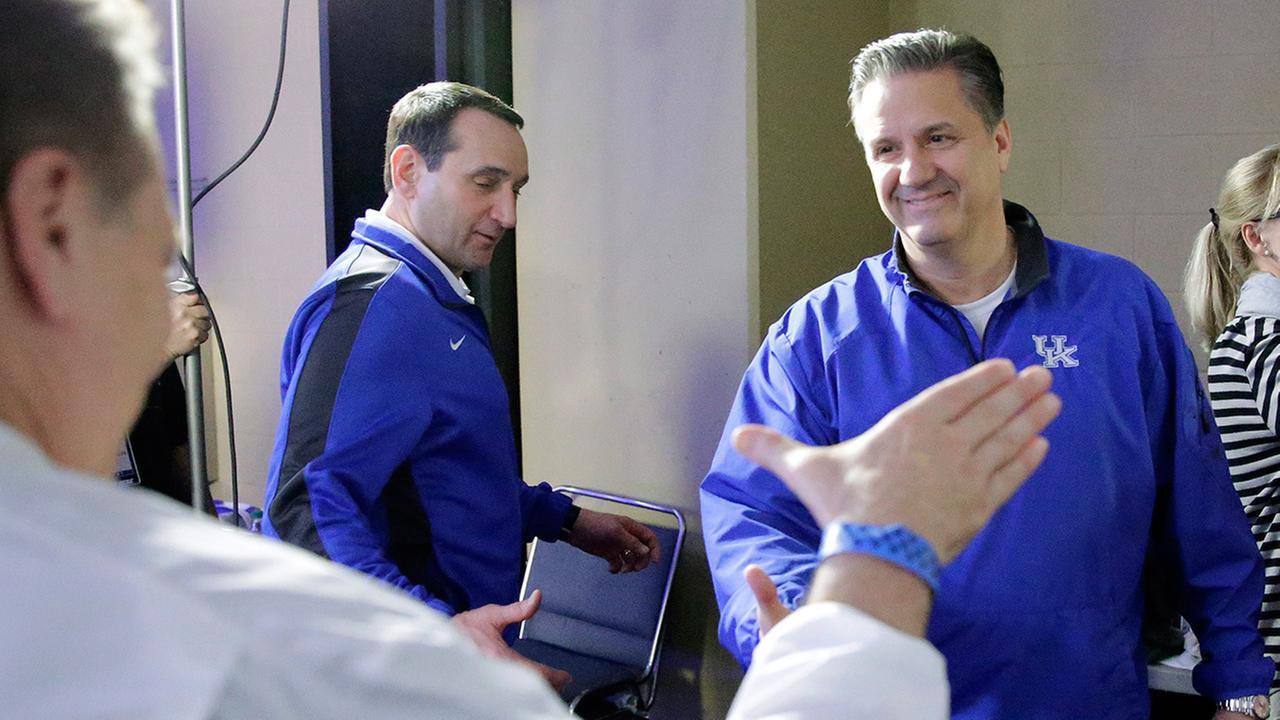 Michigan State head coach Tom Izzo, Kentucky head coach John Calipari, Duke head coach Mike Krzyzewski get ready for a CBS Sports interview Thursday, April 2, 2015.
