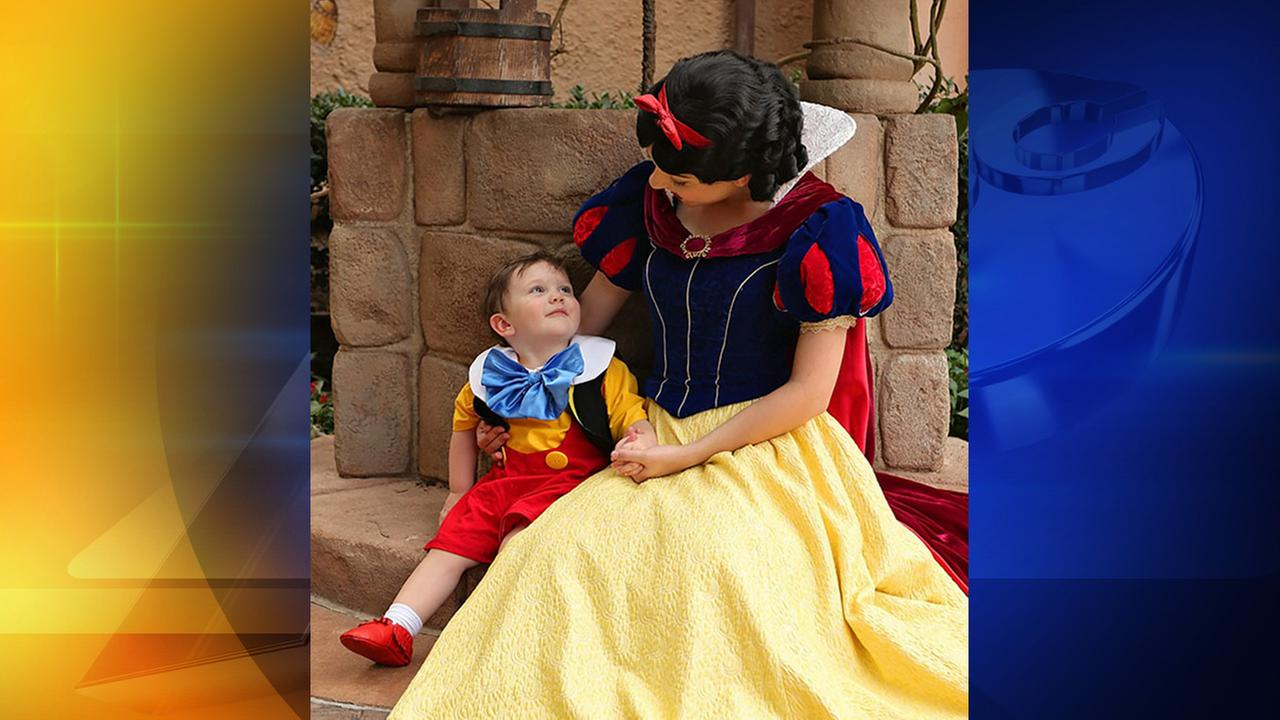 Jackson Coley, or Jack Jack, sits with Snow White at Walt Disney World.