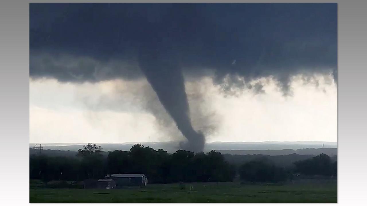 This image made from a video taken through a car window shows a tornado near Wynnewood, Okla., Monday, May 9.Hayden Mahan via AP