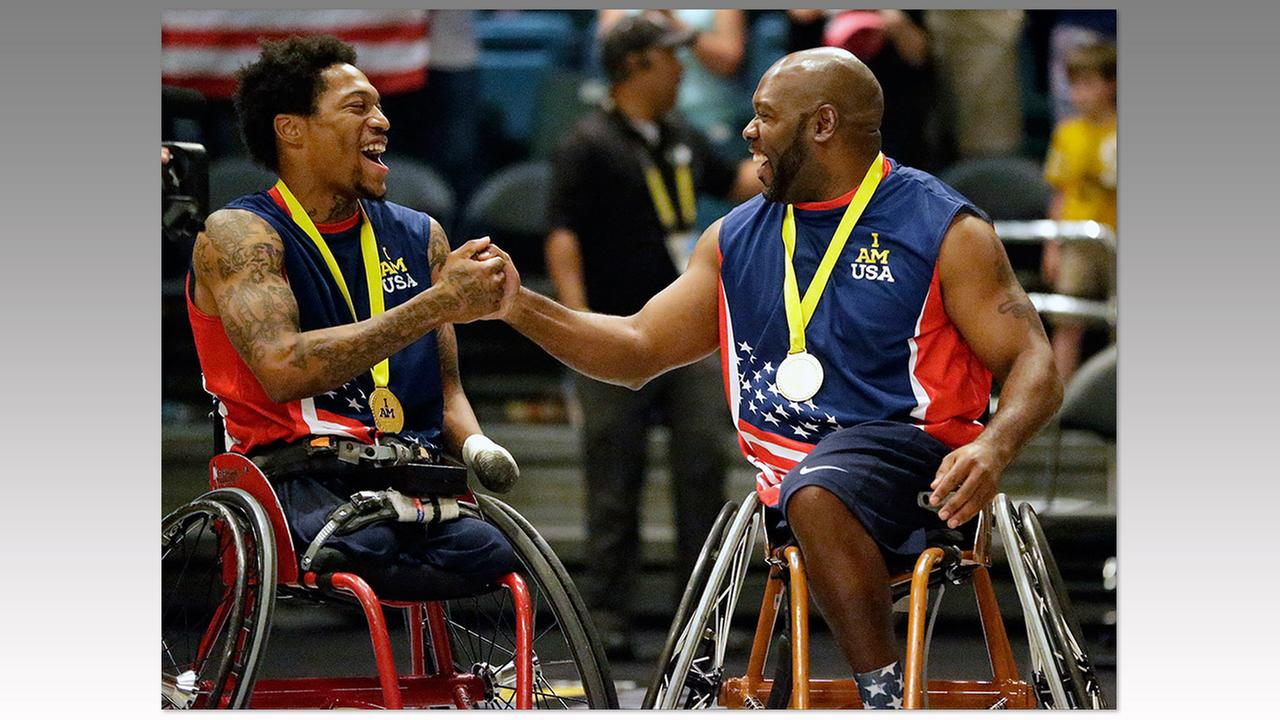USA wheelchair basketball players Anthony McDaniel, left, and Chuck Armistead celebrate after winning the gold medal at the Invictus Games, Thursday, May 12, in Kissimmee, Fla.John Raoux