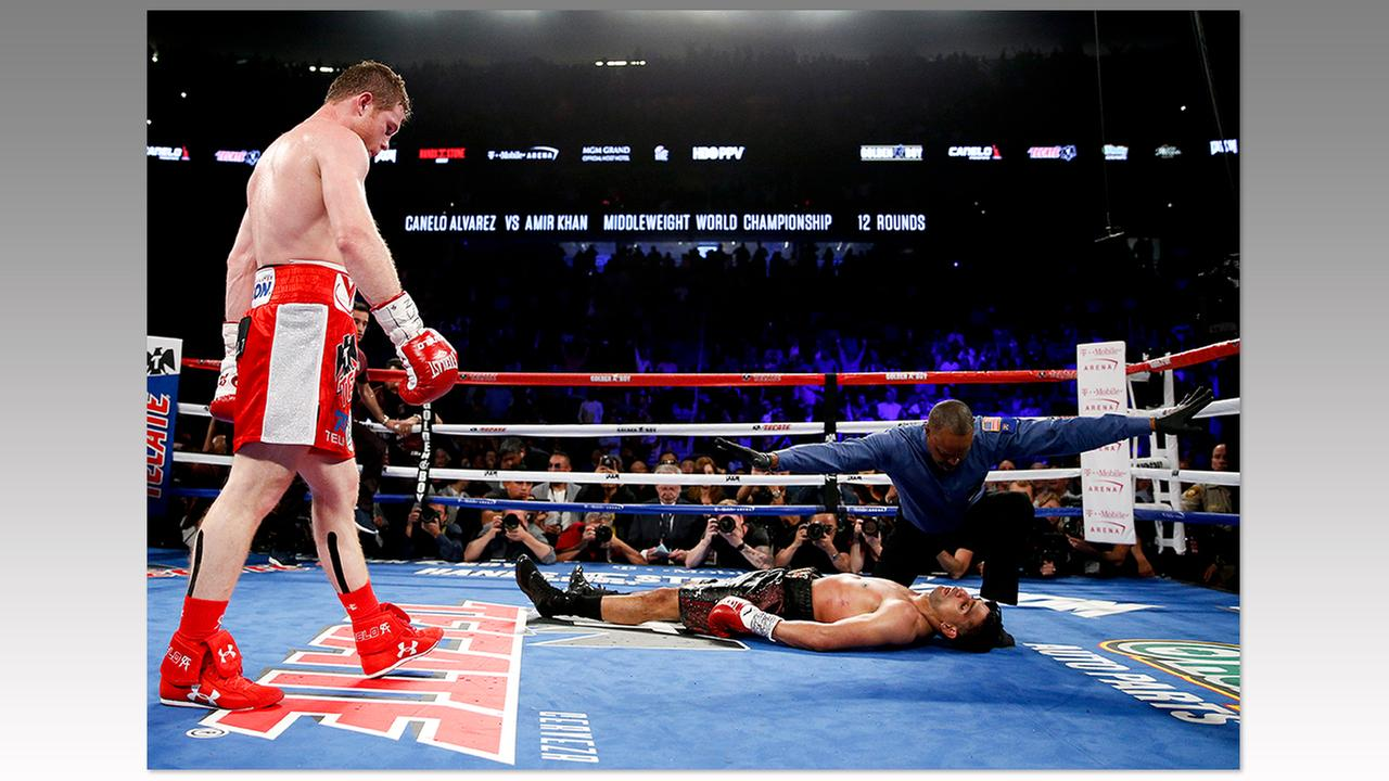 Canelo Alvarez, left, watches after knocking out Amir Khan during their WBC middleweight title fight Saturday, May 7, 2016, in Las Vegas.John Locher