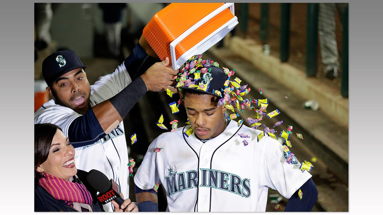 Seattle Mariners Ketel Marte, right, gets a shower of bubble gum from Nelson Cruz after a win Monday, May 9.Elaine Thompson