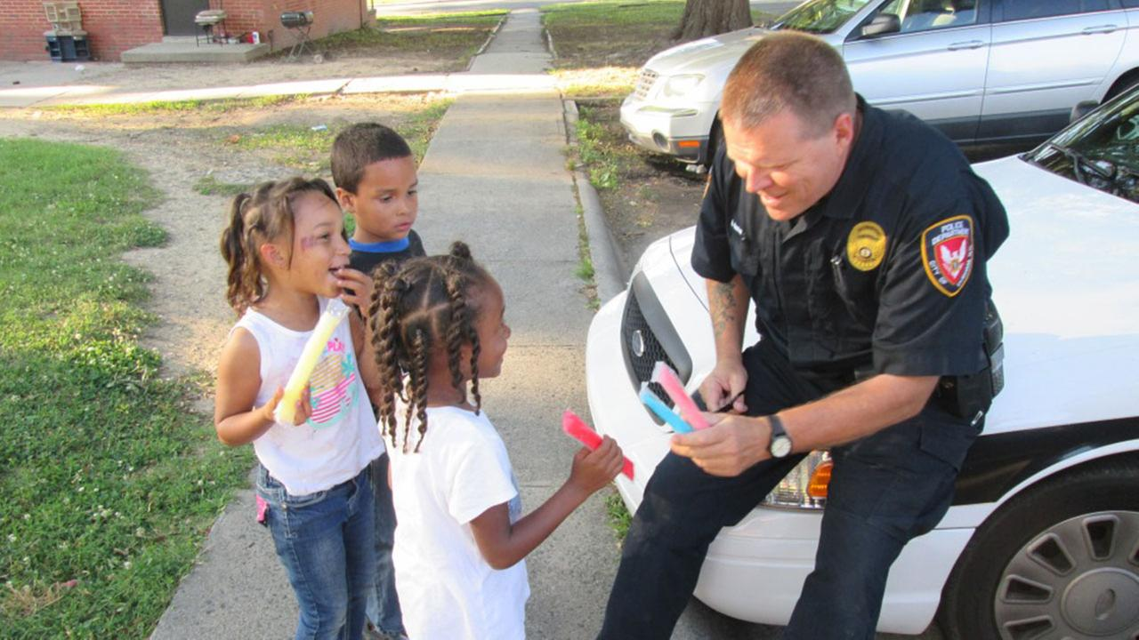 Durham police officers paid for and passed out over 500 freeze pops to local kids and residents.