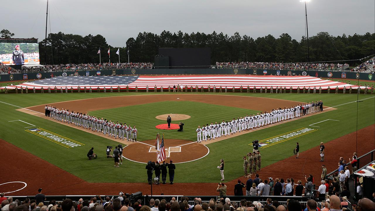 Players line up prior to a baseball game between the Miami Marlins and Atlanta Braves in Fort Bragg, N.C., Sunday, July 3, 2016.