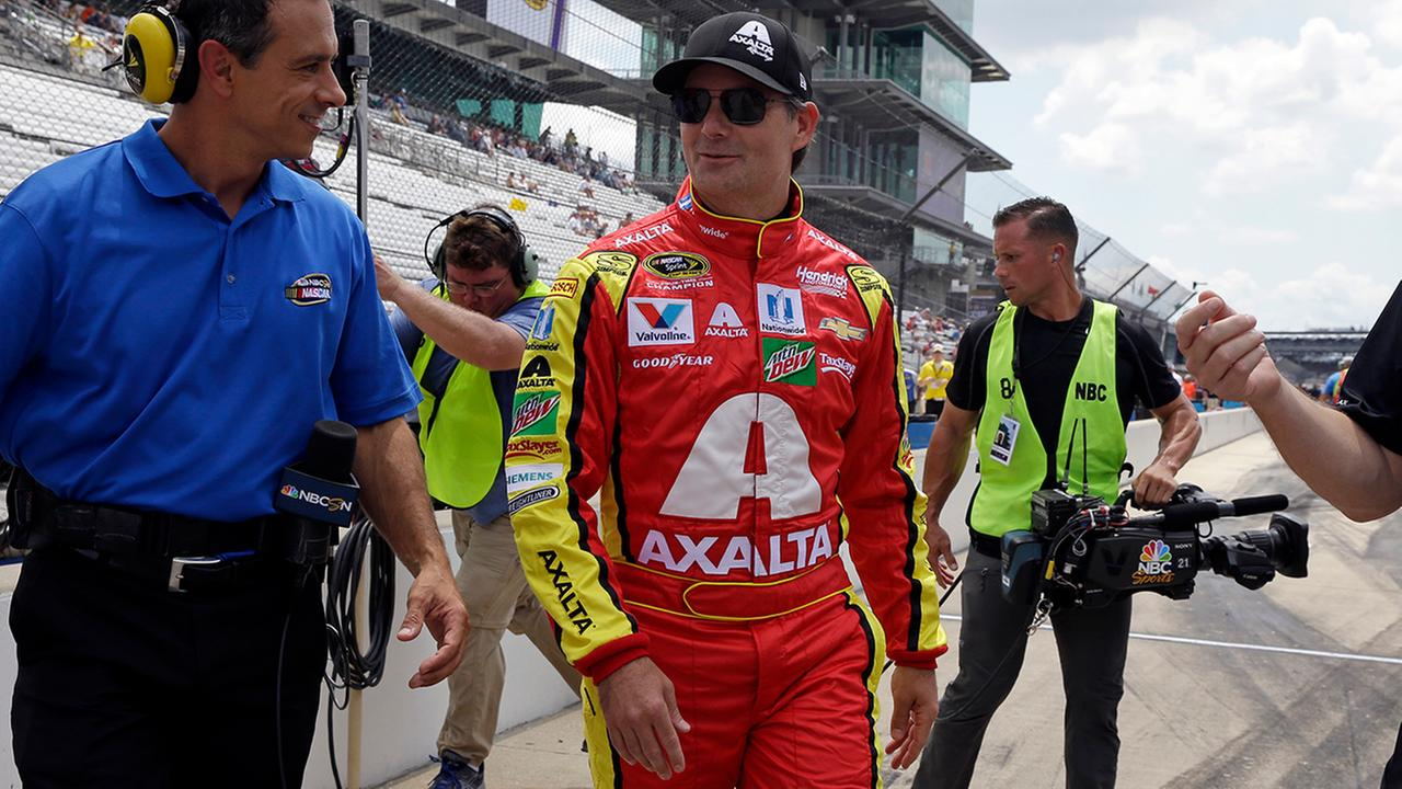 Sprint Cup Series driver Jeff Gordon (88) makes his way to his car before qualifications for the Brickyard 400 NASCAR auto race at Indianapolis Motor Speedway in Indianapolis