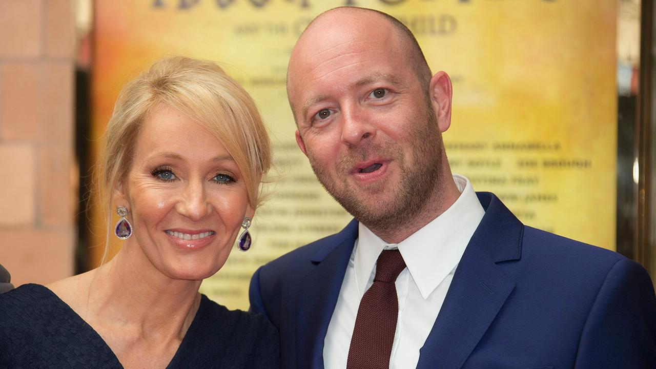 Writer J.K. Rowling, left and Director John Tiffany pose for photographers upon arrival at gala performance of Harry Potter and the Cursed Child, at the Palace Theatre