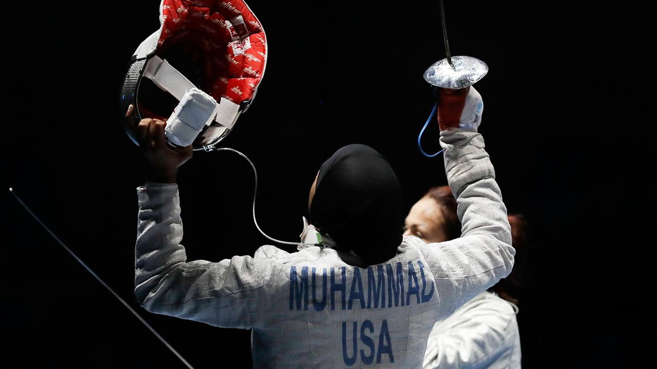Ibtihaj Muhammad od the United States, left, celebrates after defeating Olena Kravatska of Ukraine in the womens individual saber fencing event at the 2016 Summer Olympics in Rio.