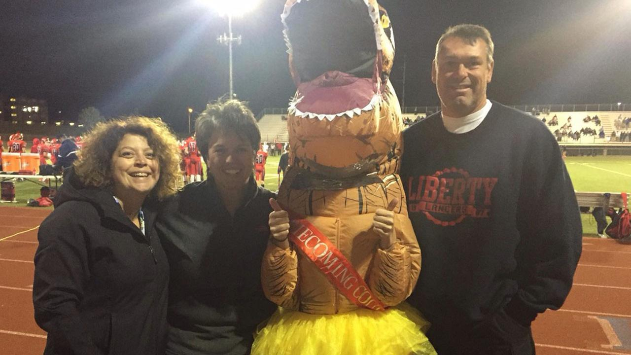 Sarah MacDonald wins homecoming queen in T-Rex costume