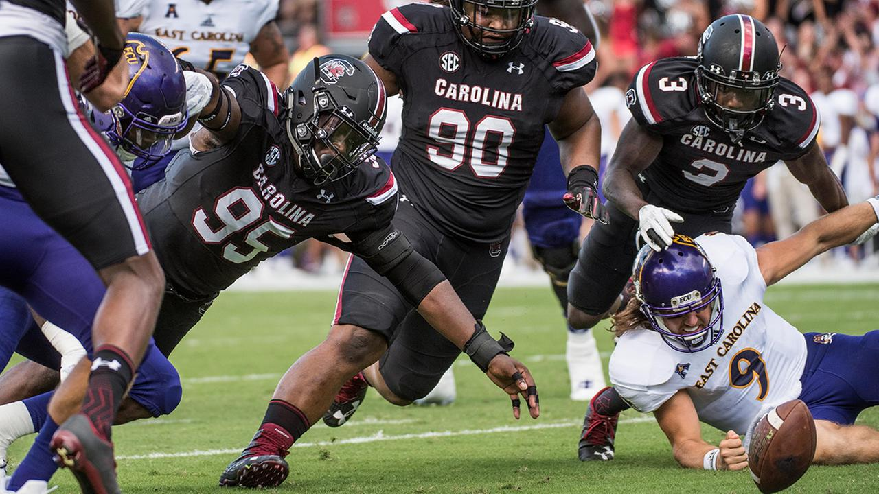 South Carolina defensive lineman Dante Sawyer (95), Taylor Stallworth (90), and Chris Lammons (3) attempt to recover a fumble by East Carolina quarterback Philip Nelson (9)
