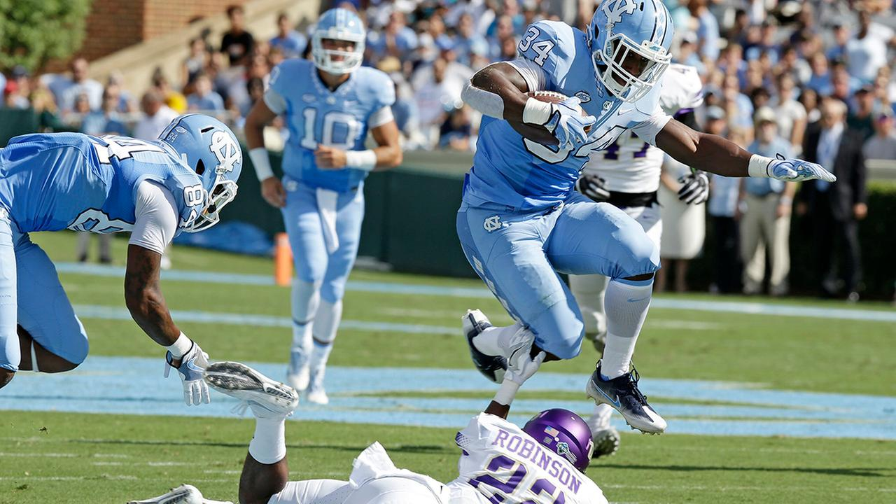 North Carolinas Elijah Hood (34) jumps over James Madisons Rashad Robinson (22) in the first half of an NCAA college football game in Chapel Hill, N.C., Saturday, Sept. 17, 2016.