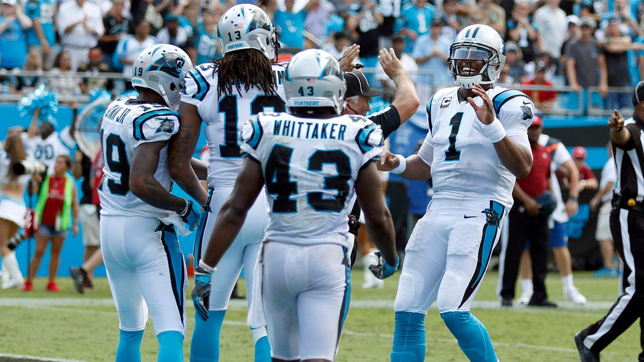 Carolina Panthers Cam Newton (1) celebrates with teammates after a touchdown against the San Francisco 49ers in the second half of an NFL football game in Charlotte, N.C.