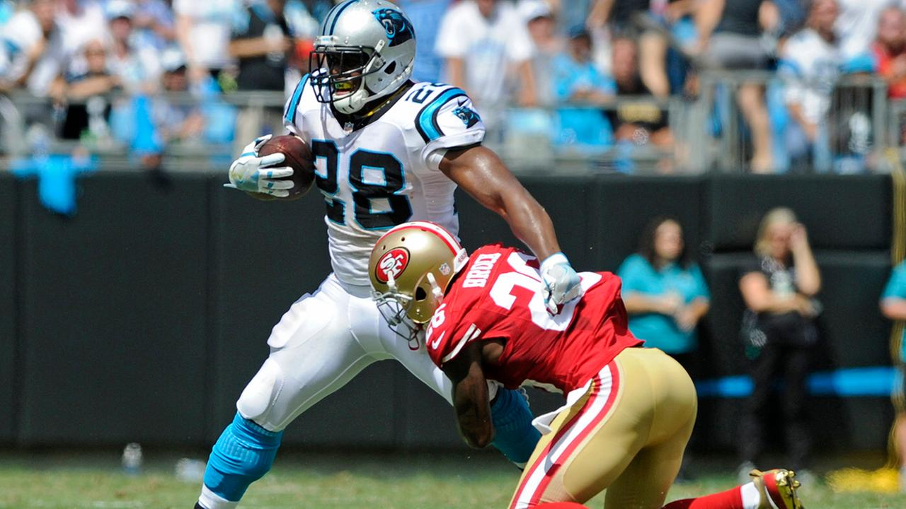Carolina Panthers Jonathan Stewart (28) is tackled by San Francisco 49ers Tramaine Brock (26) in the first quarter of an NFL football game in Charlotte, N.C., Sunday, Sept. 18