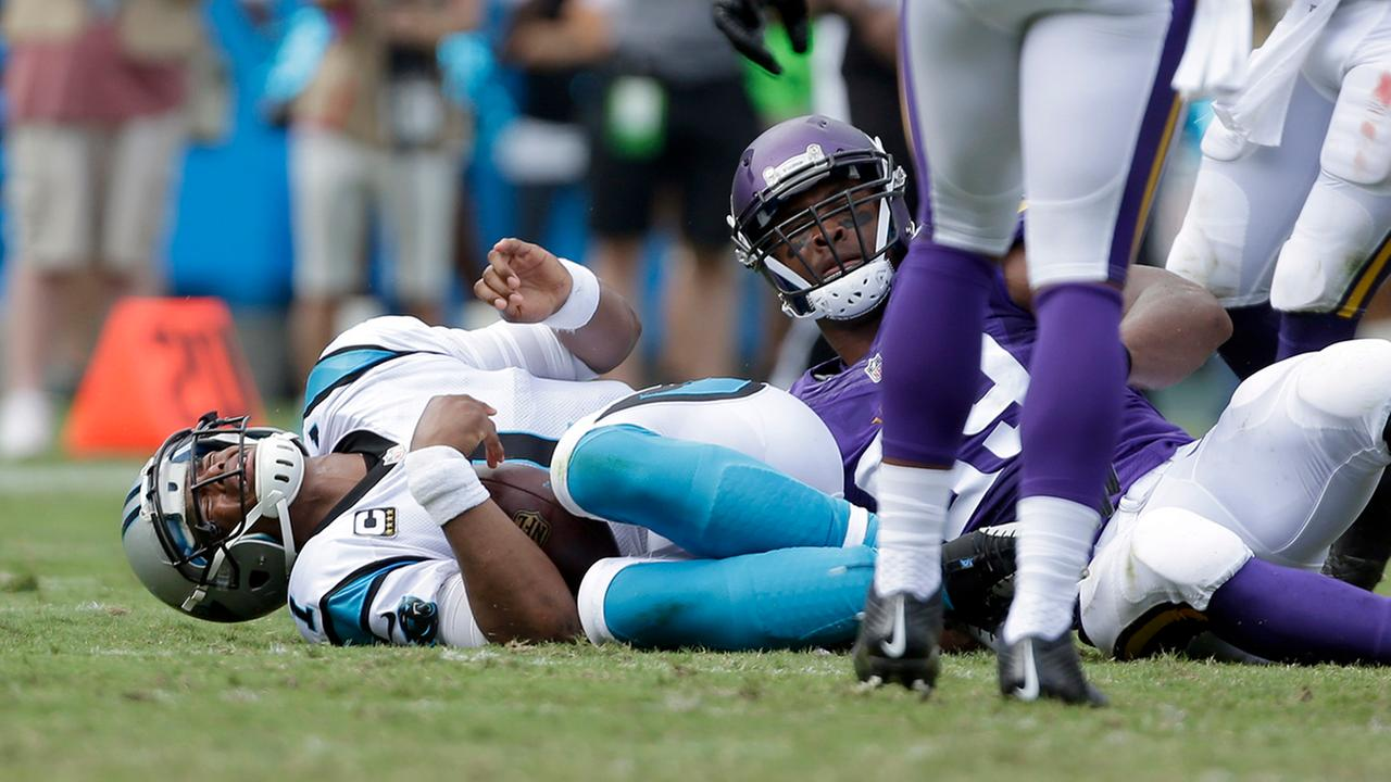 Carolina Panthers Cam Newton (1) reacts to being tackled in the first half of an NFL football game against the Minnesota Vikings in Charlotte, N.C., Sunday, Sept. 25, 2016.