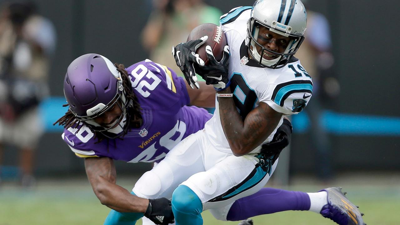 Carolina Panthers Ted Ginn (19) is tackled by Minnesota Vikings Trae Waynes (26) in the first half of an NFL football game in Charlotte, N.C., Sunday, Sept. 25, 2016.