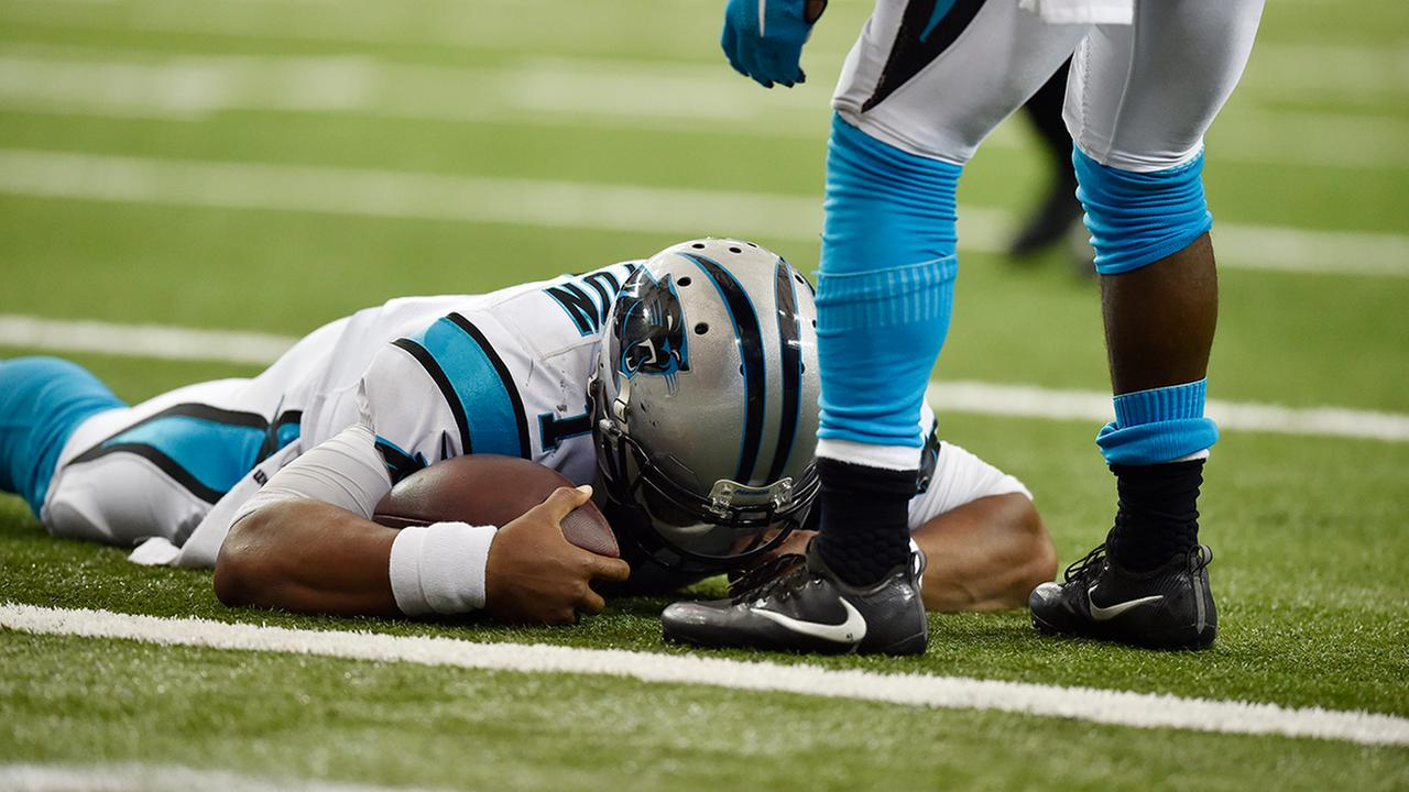 Carolina Panthers quarterback Cam Newton (1) lies on the turf after a hit during a two-point conversion against the Atlanta Falcons