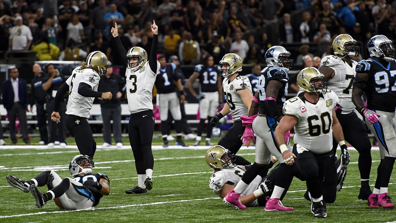 New Orleans Saints kicker Wil Lutz (3) celebrates after kicking the game winning field goal in the second half of an NFL football game against the Carolina Panthers