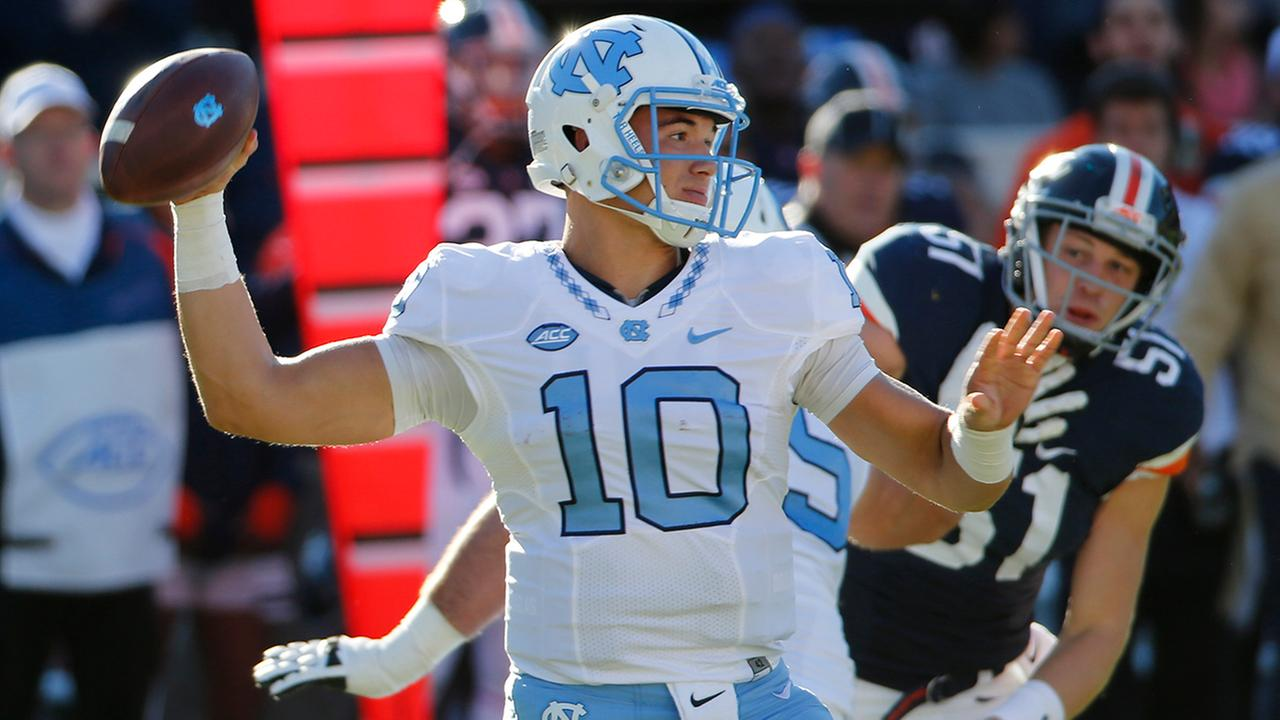 North Carolina quarterback Mitch Trubisky (10) tosses a pass during the first half of an NCAA college football game between North Carolina and Virginia at Scott stadium