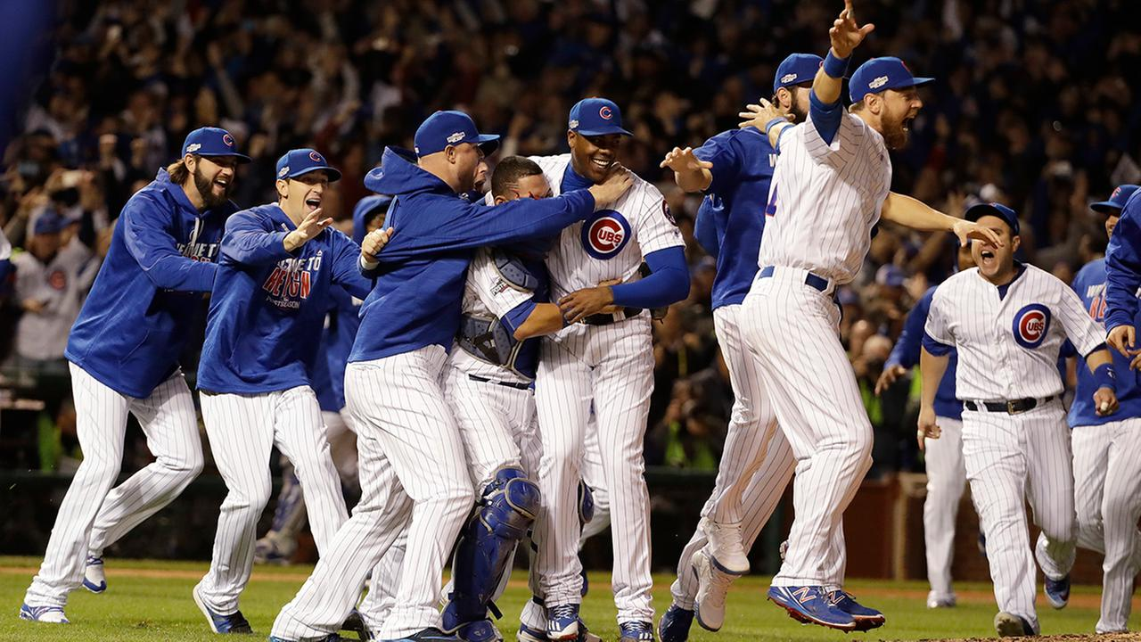 Chicago Cubs players celebrate after Game 6 of the National League baseball championship series against the Los Angeles Dodgers, Saturday, Oct. 22, 2016, in Chicago.